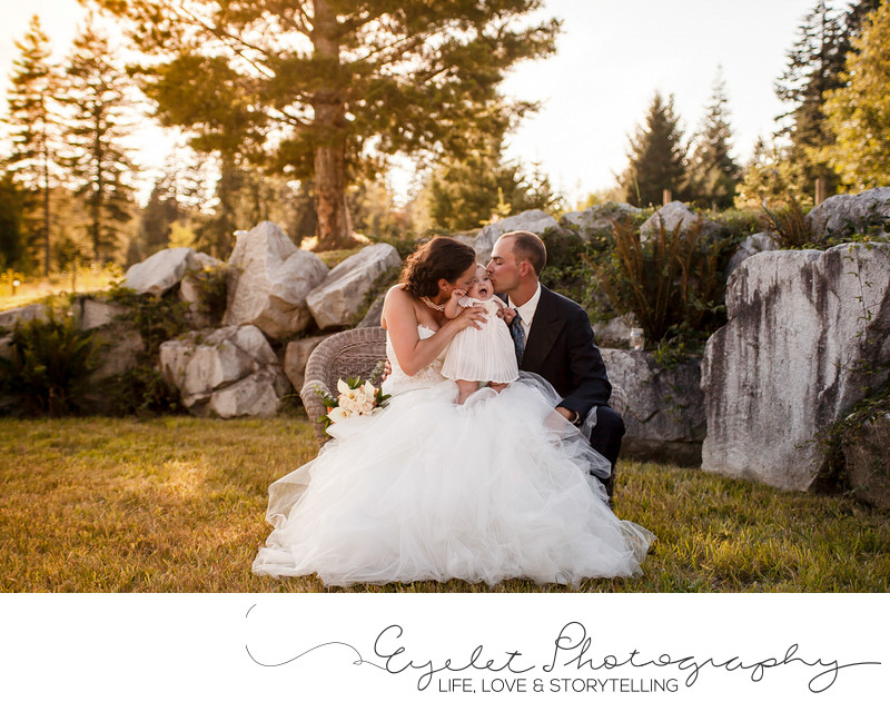 Sunset Bride and Groom Kiss Baby Wedding Photos