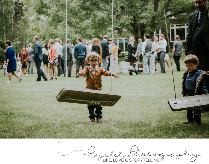 Fernie BC Backyard Wedding Ceremony Boy with Swing