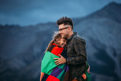 Couple in Blanket Crowsnest Pass, AB Engagement Photos