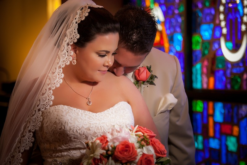 Bride and Groom in front of stained glass window