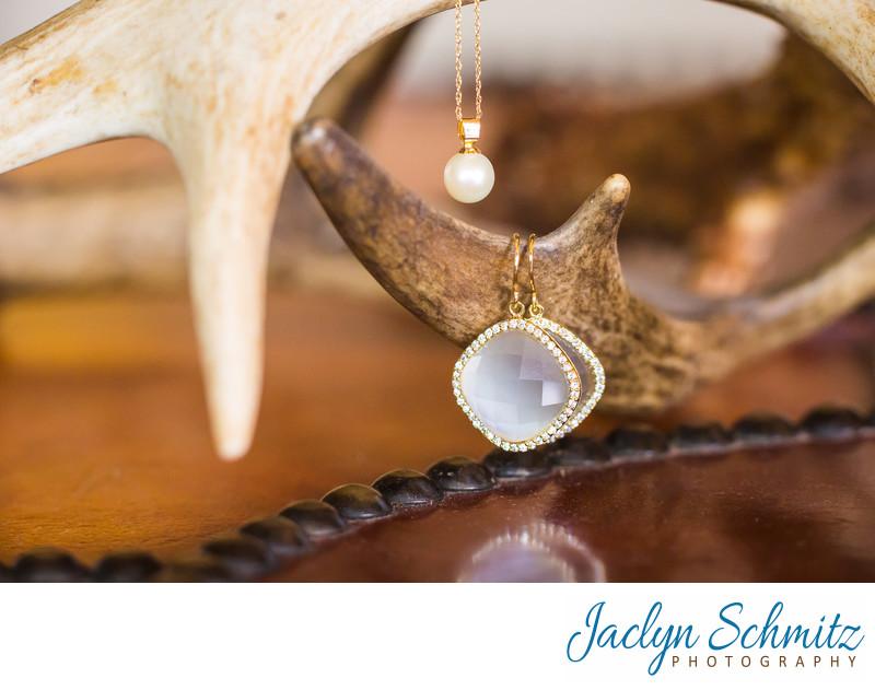 wedding jewelry balancing on antlers