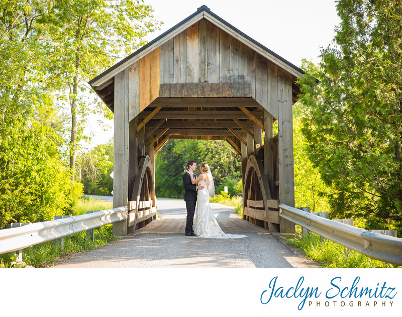 Vermont wedding photos on covered bridge