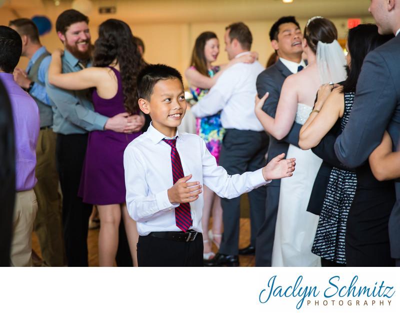 boy dances alone during wedding reception