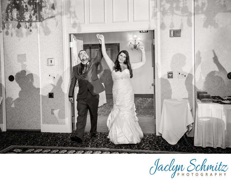 awesome wedding entrance with cheering guests