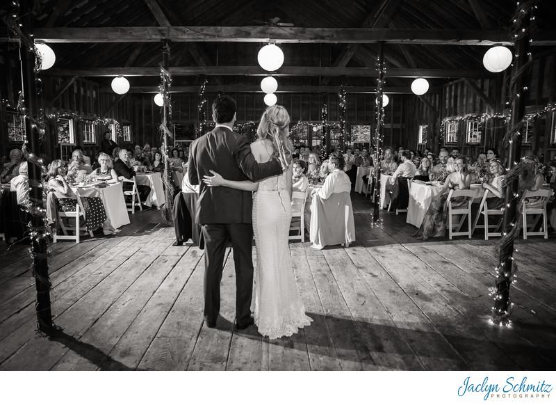 Bride and Groom hug while giving wedding thank you speech