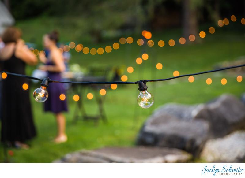Bistro lights hanging outdoor cocktail hour