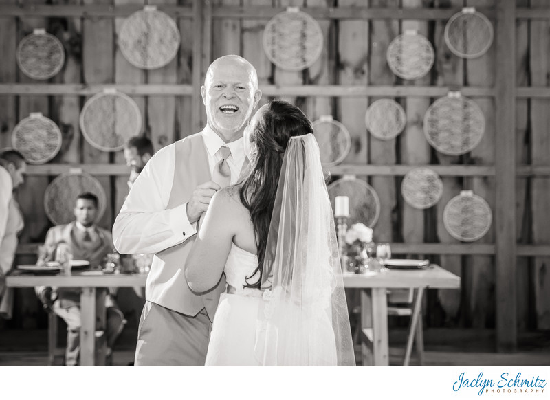 Laughing father of the bride first dance