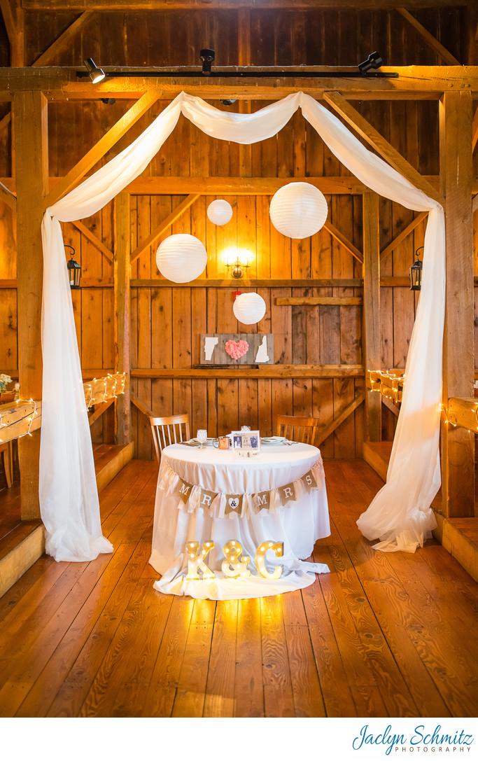White drapery head table wedding