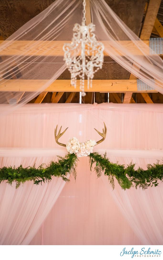 Romantic deer antler wedding ceremony decor