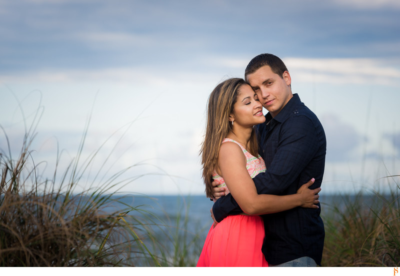 Engagement Photos at the Jacksonville Beach with a pink dress