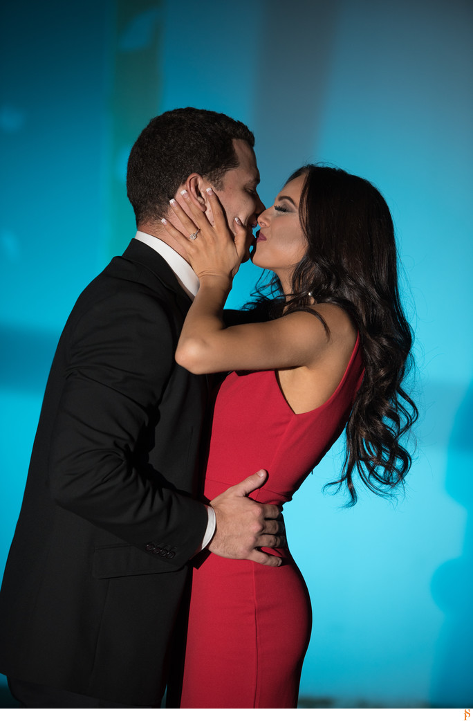 RED DRESS FOR ENGAGEMENT PHOTOS WITH BLACK SUIT