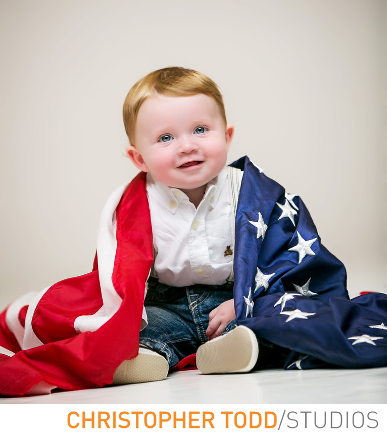 Portrait of one year old with American Flag