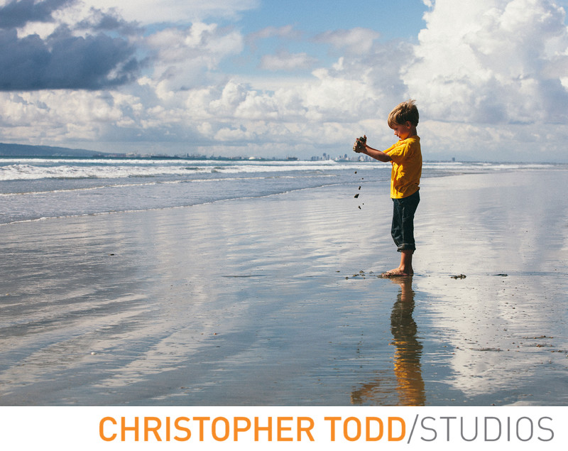 Candid Child Portrait At Beach