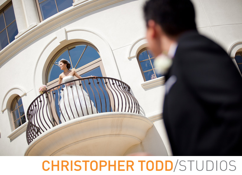 Monarch Beach Resort Groom Looking up Bride on Balcony