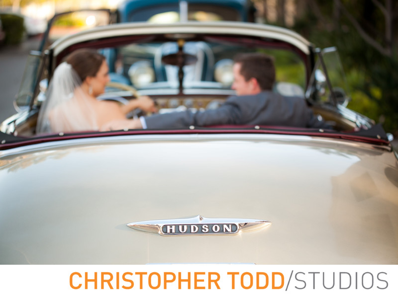 Vintage Car Outside Serra Plaza Featuring Bride & Groom