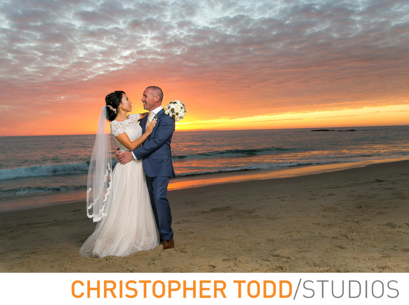 Surf and Sand Resort Bride and Groom Sunset Portait