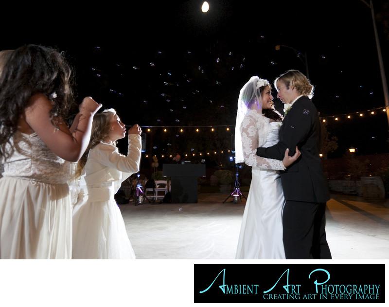 First dance of wedding couple flower girls bubbles