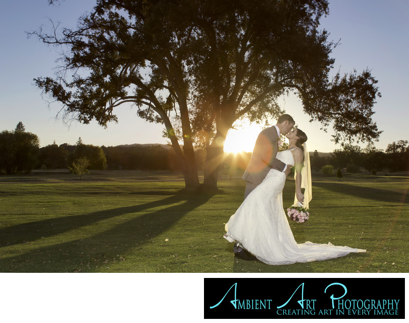 Wedding couple kissing at sunset, Ahwahnee, CA