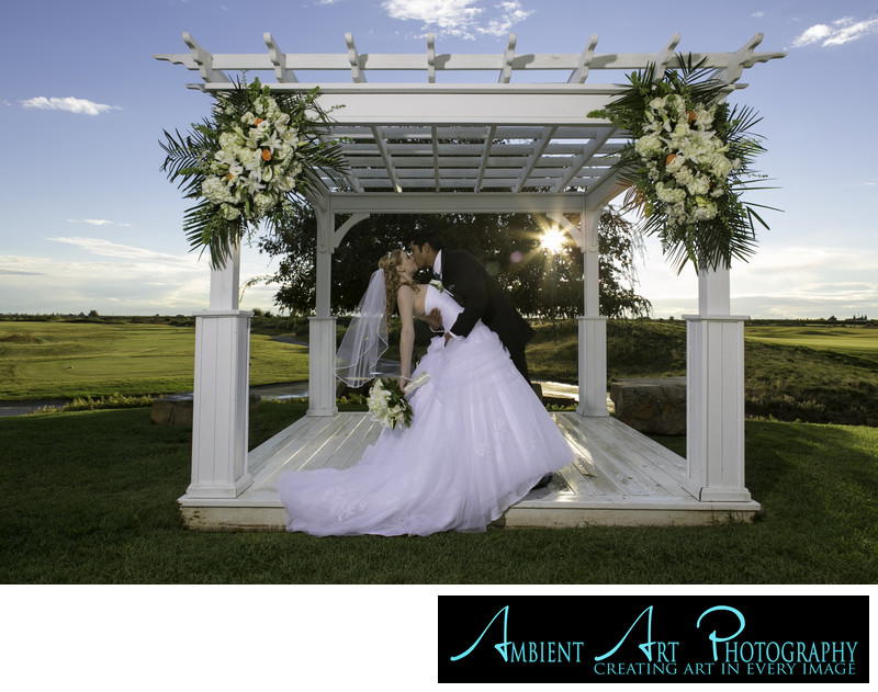 Bride and groom kissing at there wedding in Dinuba, CA