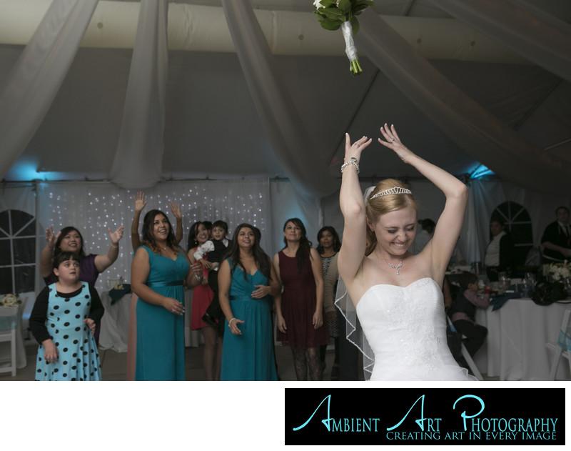Bride throwing her bouquet.  Dinuba Wedding