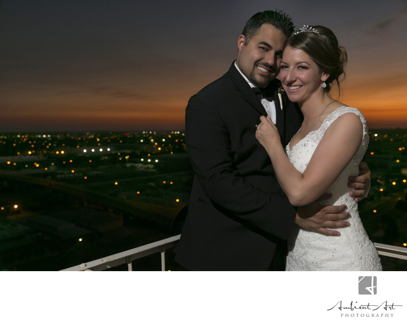 Bride and groom enjoy the view from The Grand in Fresno, CA