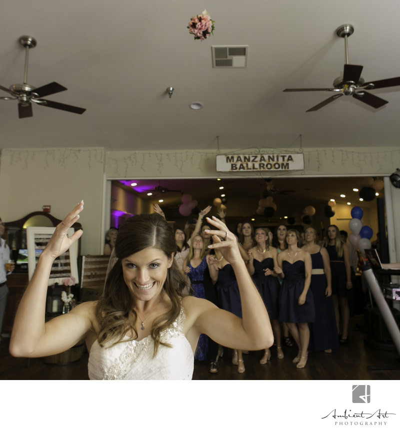 Bride throwing her bouquet at her wedding in Ahwahnee