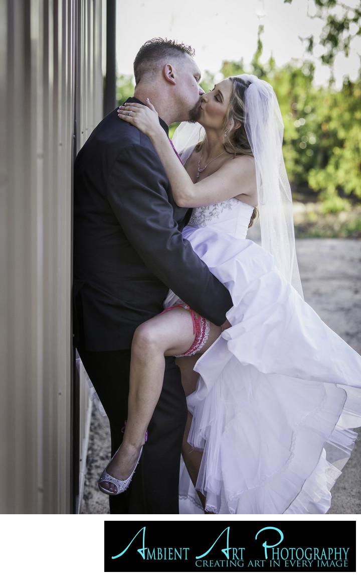 Bride and groom kissing.  Birdstone Winery