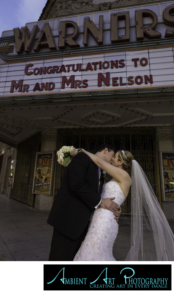 Wedding couple in front of Warnors Theater, Fresno, CA