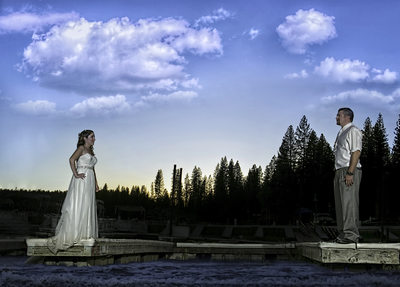 Bride and groom on Dock at Bass Lake, CA