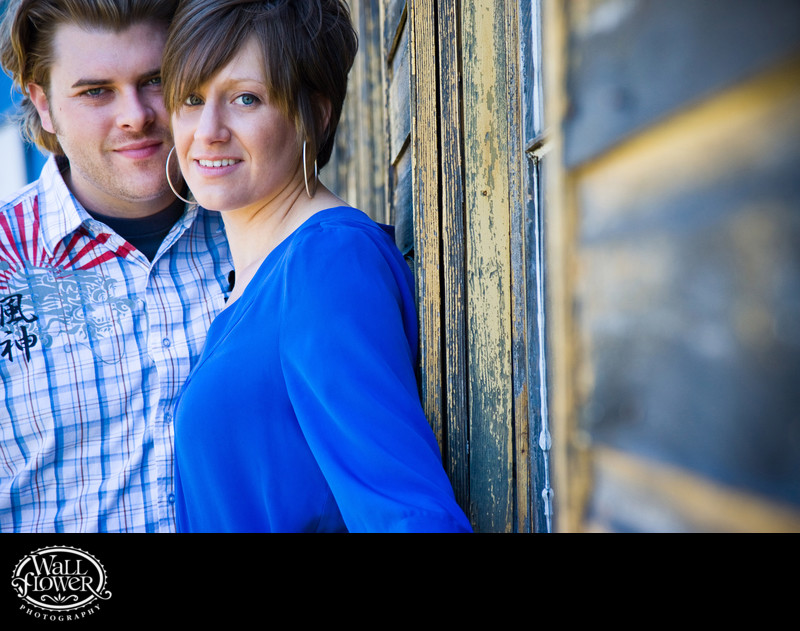 Engagement portrait by old Port of Tacoma warehouse