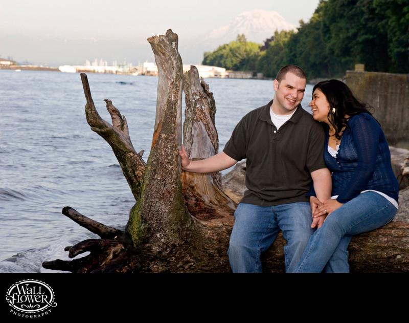 Engagement portrait of couple on Owen Beach driftwood