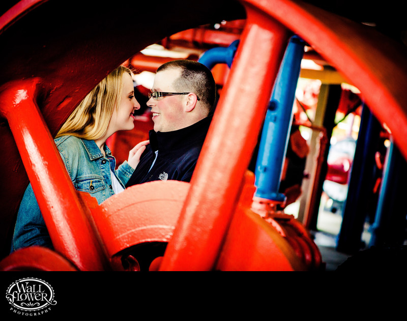 Engagement portrait by old machinery at Gas Works Park