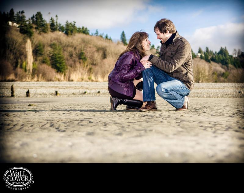 Engagement portrait on sandy beach at Golden Gardens