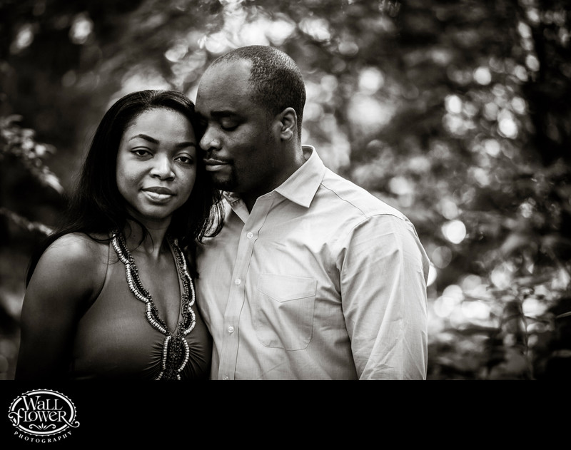 Engagement portrait with serious expressions in forest