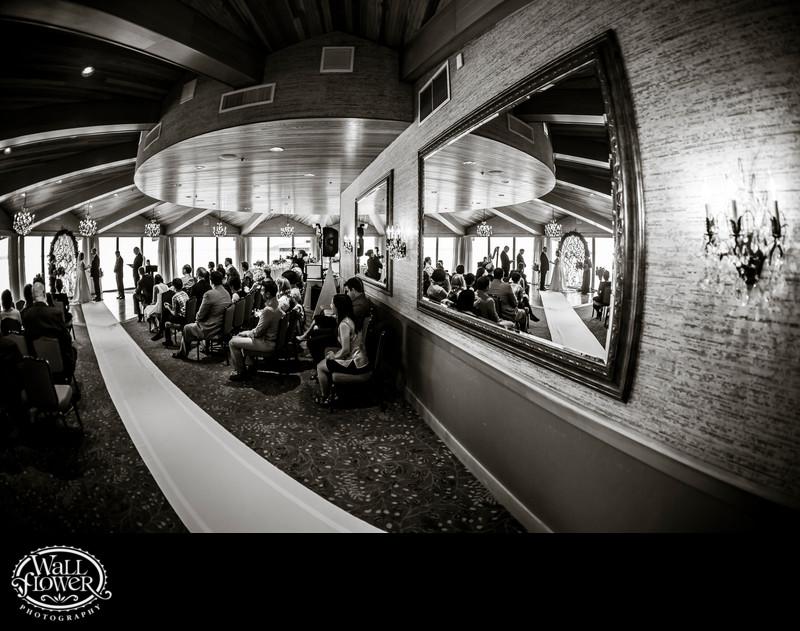 Wedding ceremony in Edgewater Hotel's Olympic Ballroom