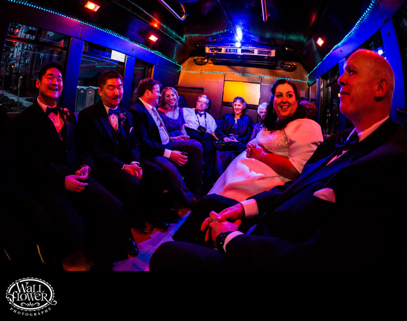 Bride and groom with families during bus ride at night