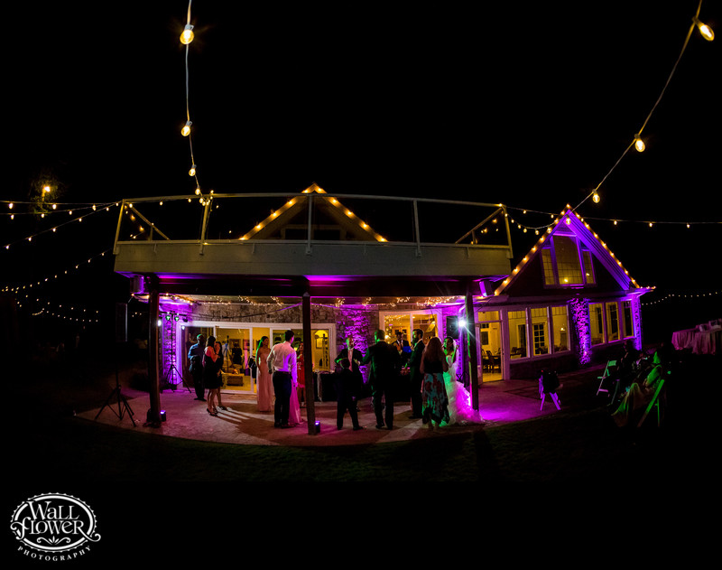 Edgewater House wedding reception lit up at night