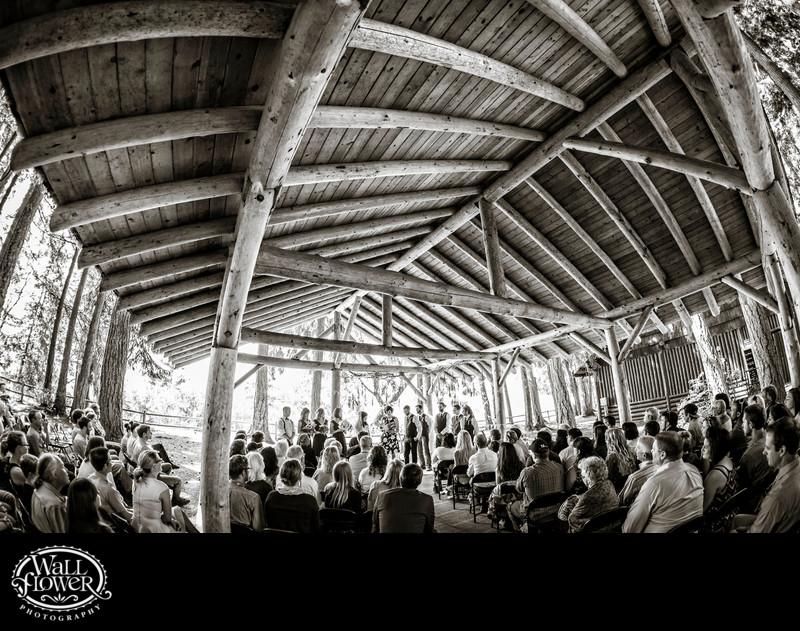 Wedding ceremony under Kitsap Memorial log pavilion