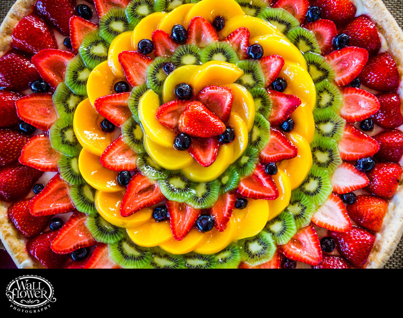 Detail of glazed fruit and berry tart at wedding