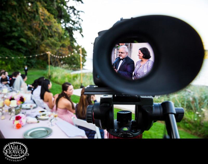 Detail through camera viewfinder during wedding toasts