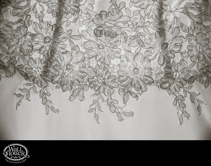 Detail of stitching on bride's backlit wedding dress