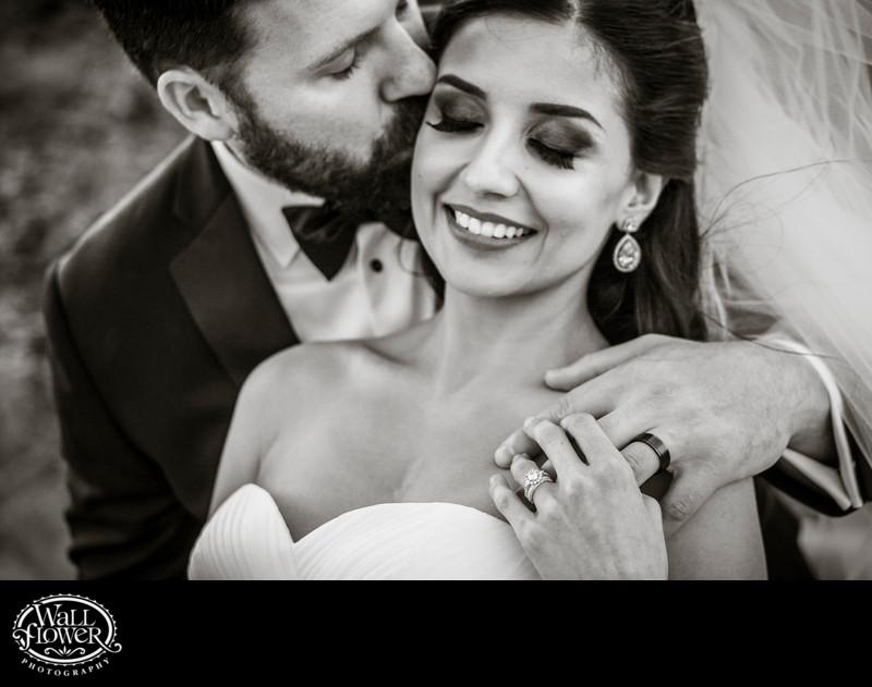 Groom kisses bride in tightly framed shot