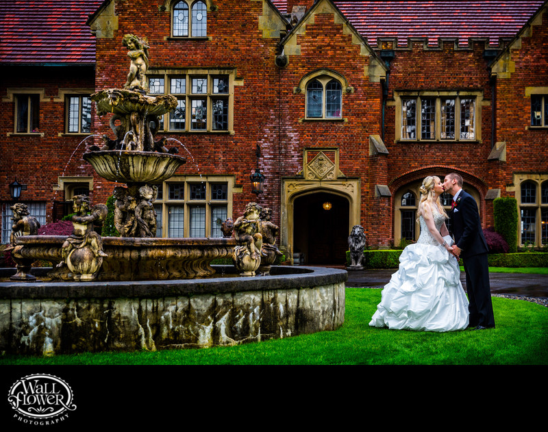 Wedding kiss at Thornewood Castle's Rose Red fountain