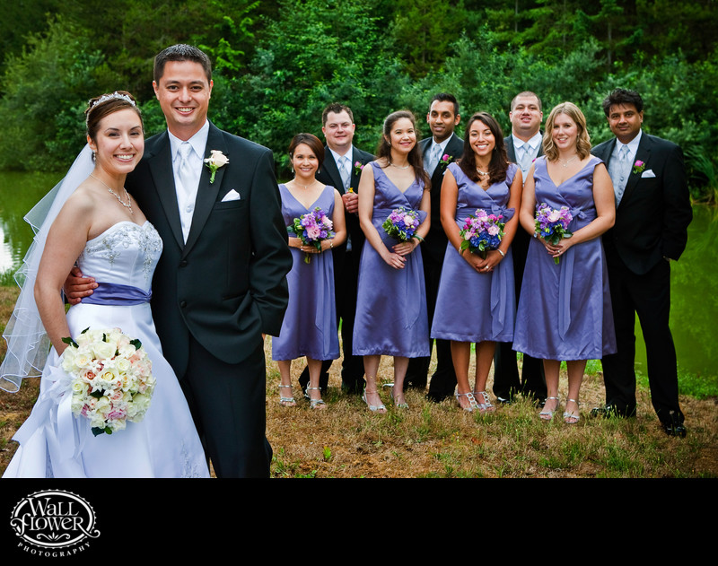 Layered wedding party portrait by McCormick Woods pond