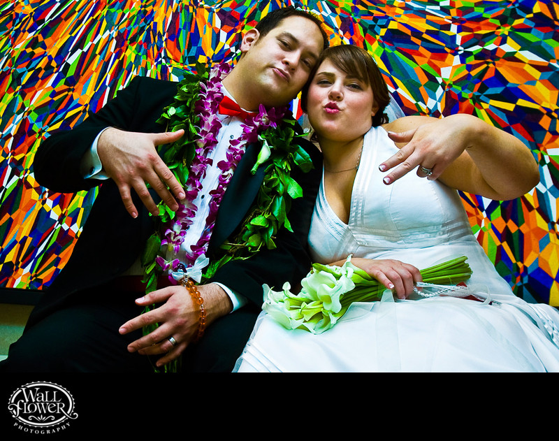 Bride and groom pose hip-hop style in Pan Pacific Hotel