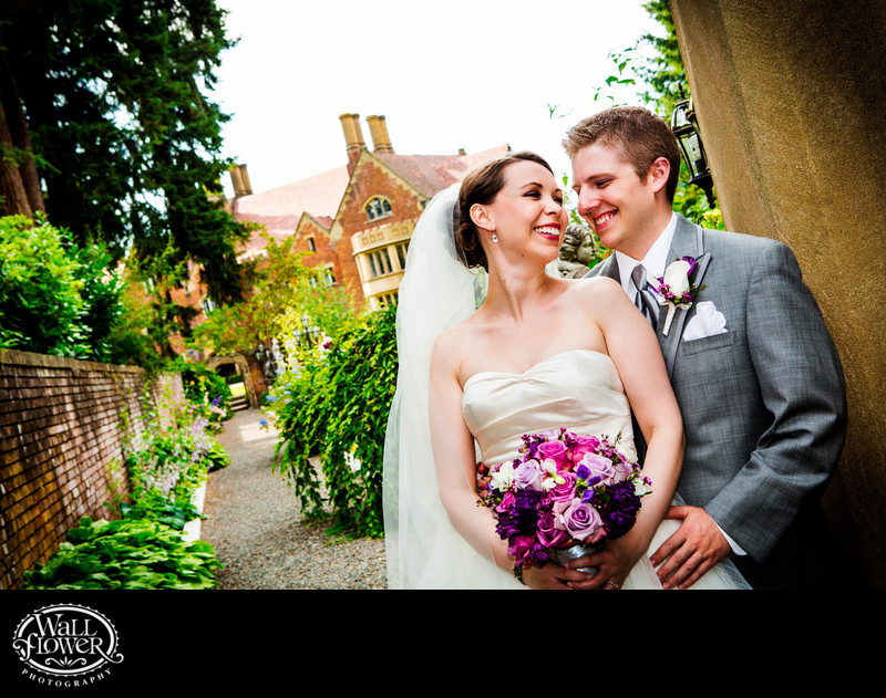 Bride and groom smile in Thornewood Castle garden