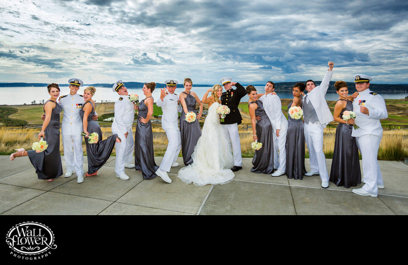 Wedding party strikes funny poses on Chambers Bay patio