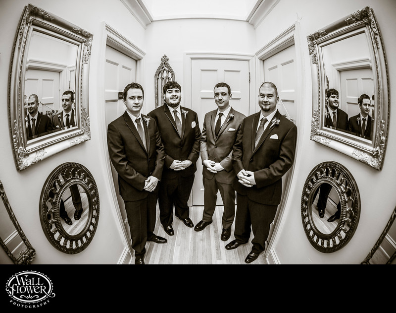 Groom and groomsmen in mirrored Thornewood Castle hall