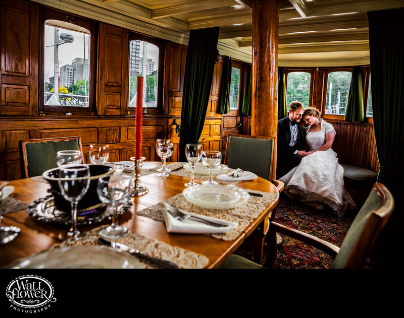 Bride and groom in historic Foss Waterway Seaport boat
