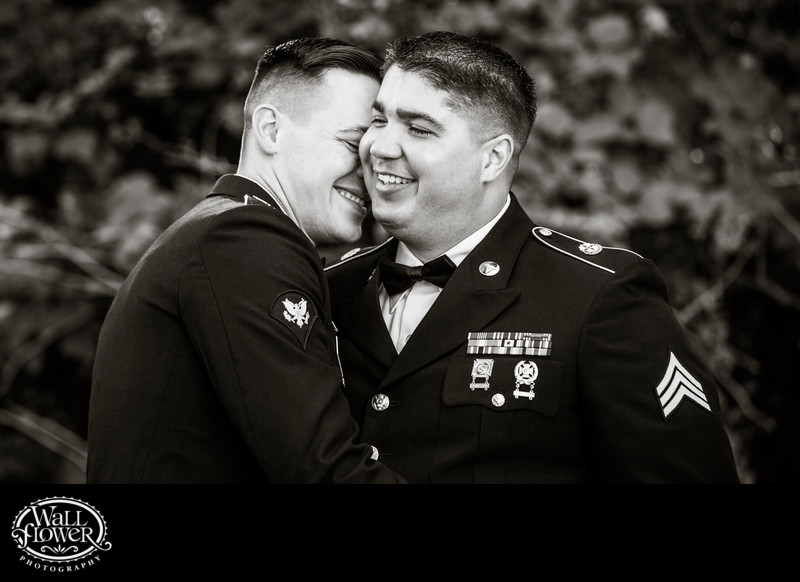 Two Army grooms nuzzling after same-sex wedding
